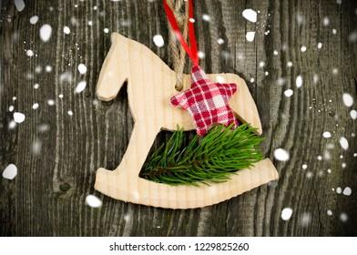 Christmas Decoration Hobbyhorse Rocking Horse on natural Wood