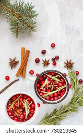 Christmas decoration: hot winter mulled wine with cranberries and spices on a light background. space for text, frame, top view.