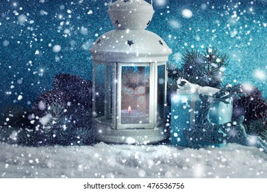 Christmas decoration with lantern ,snow and fir tree branch.