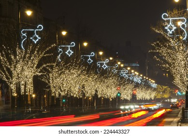 christmas decoration light bulb garlands on a row of trees, Andrassy road, Budapest, Hungary