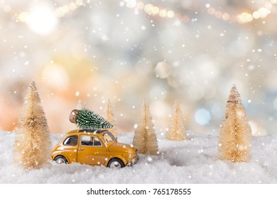 Christmas decoration with little car and tree on the roof, lots of copy space for your product or text.