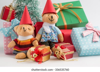 Christmas decoration with Lovely bear, a gift,  christmas tree, and ribbon