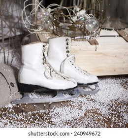 Christmas decoration made by designed vintage skates. Skates on artificial snow