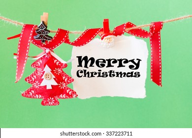 Christmas decoration with merry christmas on paper sheet over wooden background