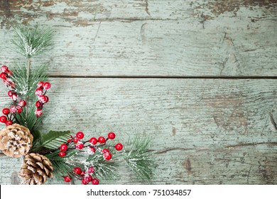Christmas decoration of mistletoe, holly with berries,ivy and pine cones - Shutterstock ID 751034857