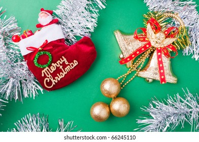 Christmas decoration objects on light green background