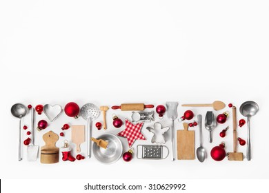 Christmas decoration of old red, white and silver cutlery and dishes.