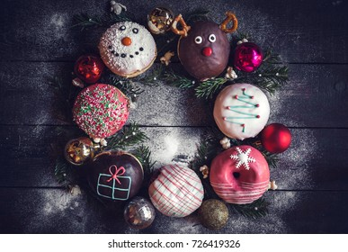 Christmas decoration on donuts with blank space in the middle