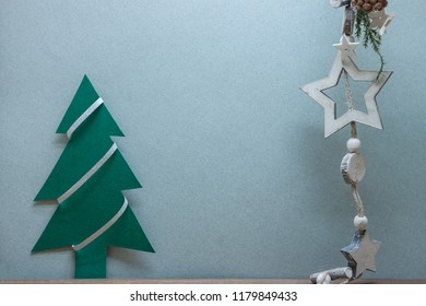 christmas decoration on grey paper background fir tree