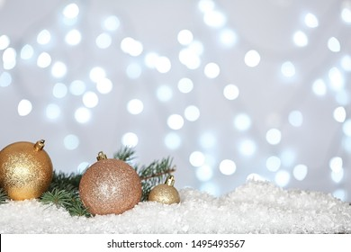 Christmas decoration on snow against blurred background, space for text