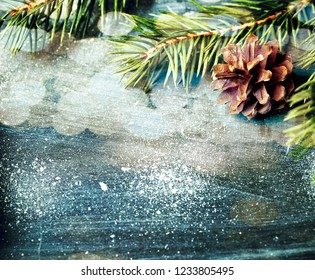Christmas decoration on snowy blue background with copy space