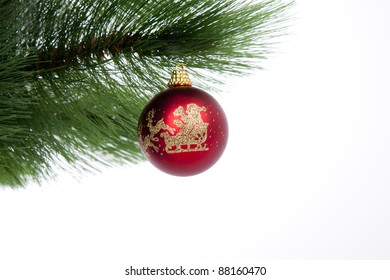 Christmas decoration on a christmas tree isolated on white