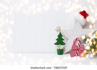 Christmas decoration on a white wooden background.