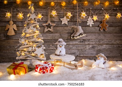 Christmas decoration on wooden background, lots of copy space for your product or text.