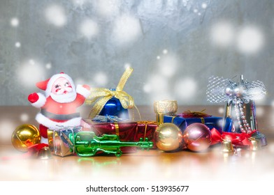 Christmas decoration on wooden desk with snow and  abstract background