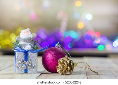 Christmas decoration on wooden table with blurred light background