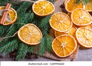 Christmas decoration, orange slice, cinnamon on rustic table