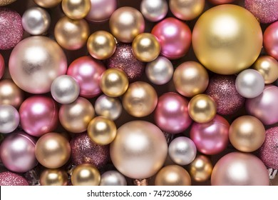 Christmas decoration ornament balls pattern. Full frame of colorful holiday decor. Top view.