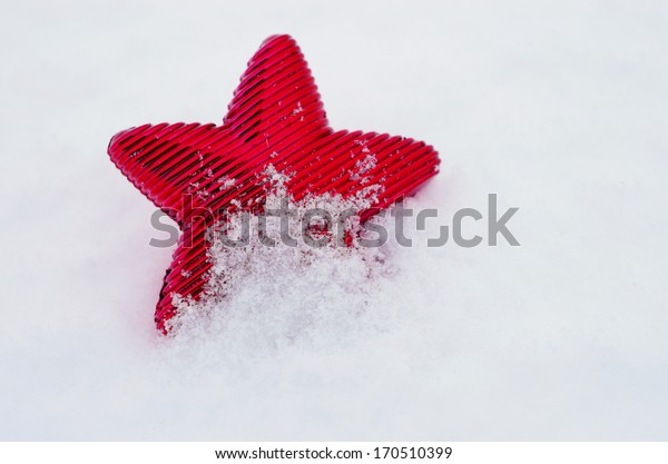 Christmas decoration outside in real snow during snowfall