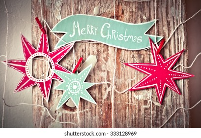 Christmas decoration over grunge background/vintage paper handmade christmas decoration and snow on wooden background with copy space