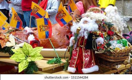 Christmas decoration of parade's float with ecuadorian flag, Santa Clause toy,  plant, food, drinks and tinsels at the Christmas parade Pase del Nino Viajero  (Traveling Child) in Cuenca.