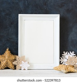 Christmas decoration and photo frame on the blue vintage background. Paper decoration and frame for quotes. New year greeting card template. Holiday mock up. Scandinavian style.