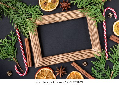 Christmas decoration with photo frame. Top View. Space for text. Christmas and New Year holiday background. Winter holidays concept.