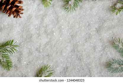 Christmas decoration with pine branches and snow