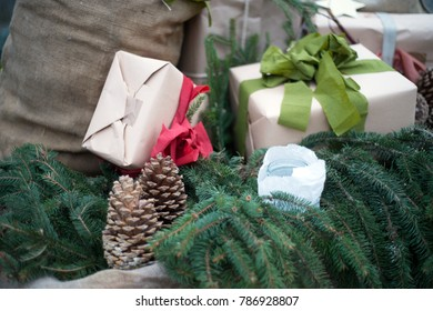 Christmas decoration with pine cones and gift
