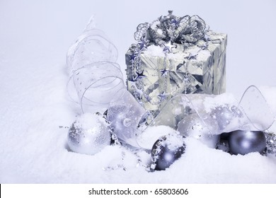 Christmas decoration and present covered with snow