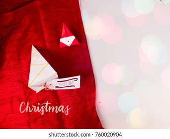 Christmas Decoration with pyramid box and red scarves cloth with snow for holidays best background image for Holiday invitation and banners