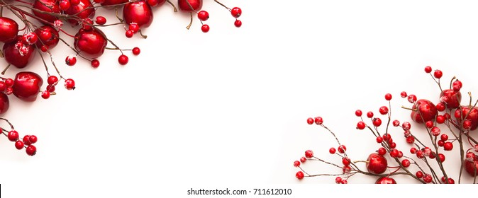 Christmas decoration with red apples and berries isolated on white