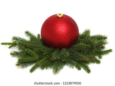 Christmas decoration: red balls with cones and fir tree branches isolated on a white background