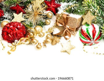 christmas decoration with red balls, golden gift box and christmas tree branches on white background