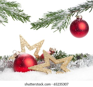 Christmas Decoration - red baubles and a branch of pine tree