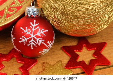 Christmas decoration red and golden - glass bauble and stars