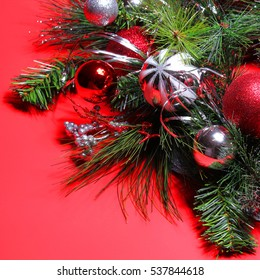christmas decoration red and silver balls on christmas tree branch over red background holiday - Christmas Tree With Red And Silver Decorations