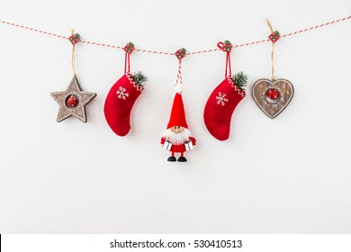 Christmas decoration with Santa on white wooden background. Copy space