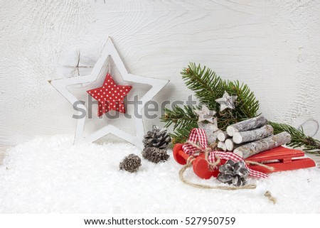 christmas decoration with christmas sleigh pine branch pine cone and christmas star on snow