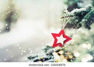 Christmas decoration with snow on winter nature background