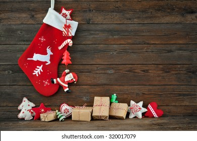 Christmas decoration stocking and toys hanging over rustic wooden background