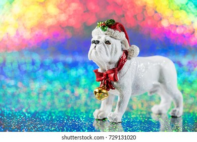 Christmas decoration with the symbol of the year of dog on the rainbow glittering background