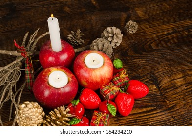 Christmas decoration with traditional objects around several red apples