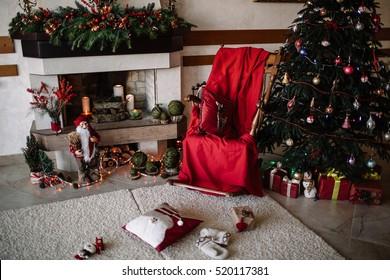 Christmas decoration: Christmas tree, fireplace, armchair-rocking chair