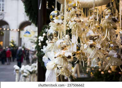 Christmas decoration for tree with white angels hanging on advent market