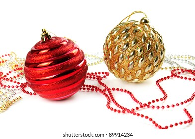 Christmas decoration with two shiny balls and tinsel