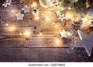 Christmas decoration in vintage style at old wooden board with star snowflake and balls.