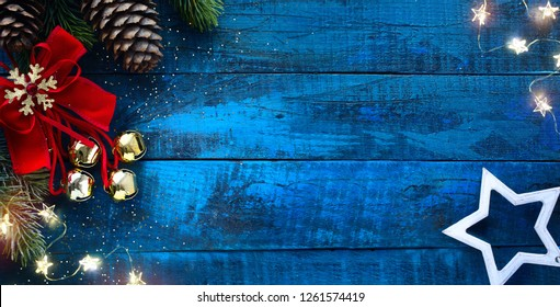 Christmas decoration in vintage style at old blue wooden board