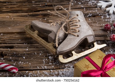 Christmas decoration, winter skates on wooden background, lots of copy space for your product or text.