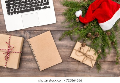 Christmas decoration and wrapped gifts. Office working place. Flat lay